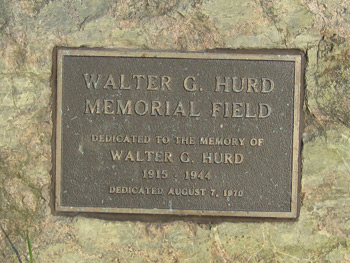the Hurd memorial plaque that is attached to a large rock in the park