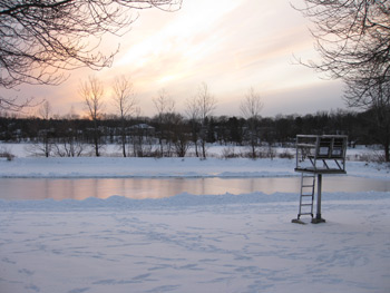winter time with the swimming area turned into a skating rink